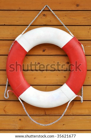 a safety ring hanging on wooden wall