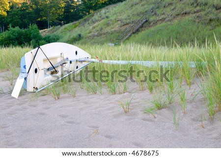 A sailboat on it's side on the beach at Lake Michigan after a rain storm.