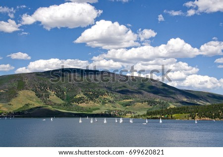 A sailboat regatta on Lake Dillon in Frisco, Colorado is always an interesting sight.  The mountains behind, however, are still showing the results of a pine beetle infestation.