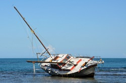 A Sailboat that has run aground and has tipped over