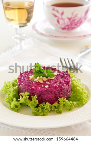 A salad of beets and nuts. Selective focus.