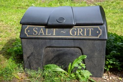 A salt and grit bin in the street ready for winter use