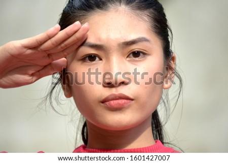 A Saluting Beautiful Minority Female