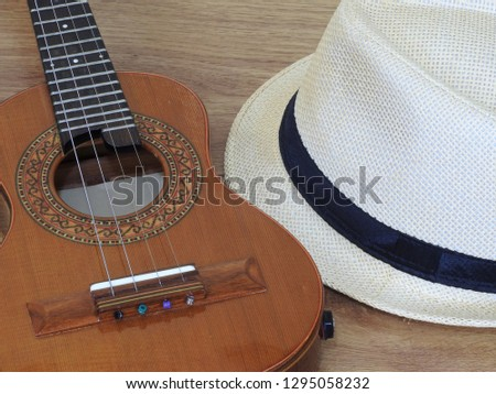 A samba player (sambista) hat and a cavaquinho, a small Brazilian string musical instrument. It is widely used to accompany samba and choro, two popular Brazilian rhythms.