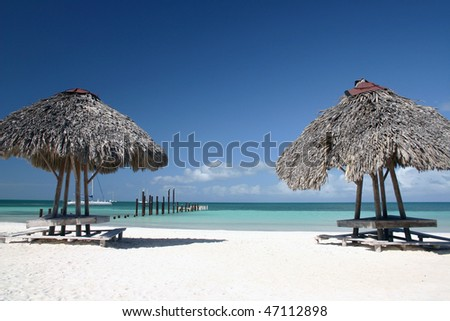 A sand beach with two small summerhouse of small island  in Varadero, Cuba.
