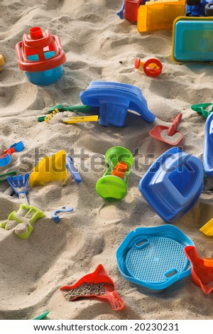 a sand box with a toys is in a supermarket