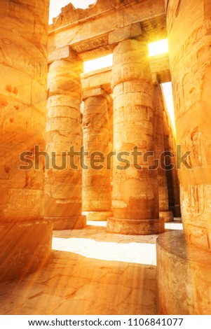 A sandstone column in Egypt.  columns covered in hieroglyphics #1106841077