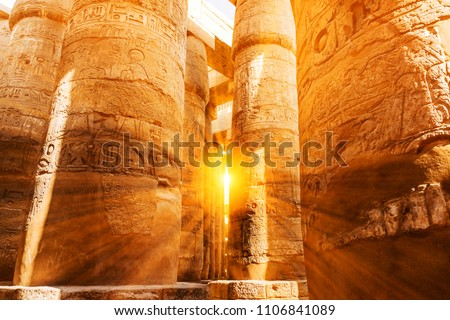 A sandstone column in Egypt.  columns covered in hieroglyphics #1106841089