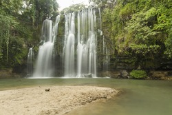 A sandy beach at a popular swimming hole at Llanos de Cortes  waterfall near Bagaces, Costa Rica