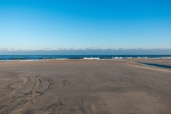 A sandy shore under the blue sky in Norderney