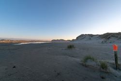 A sandy shore under the blue sky in the evening in Norderney