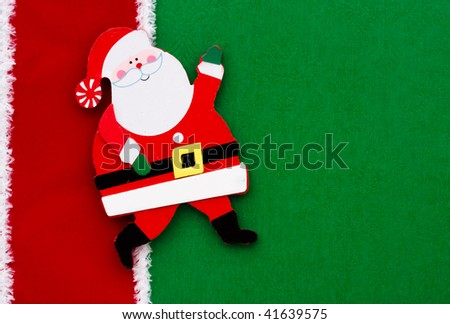 A santa claus on a green background with red ribbon