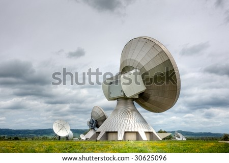 A satellite communications installation in a country setting. Poor weather.
