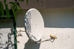 a satellite dish hanging on a wall