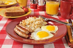 A sausage and egg breakfast with toast