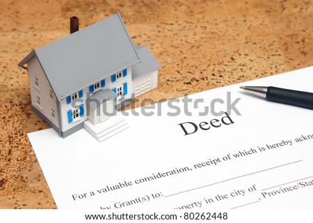 A scale house on some forms for a deed to conceptualize on the financial investment.