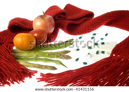 A scarf wrapped around fruits, vegetables, medicaments, handkerchiefs representing health care.