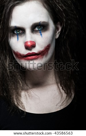 creepy clown makeup. stock photo : a scary and evil