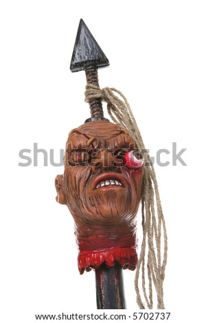 A scary Halloween prop of a shrunken head on a spear