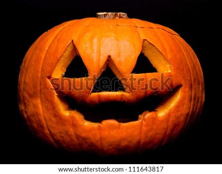A scary Halloween pumpkin on black