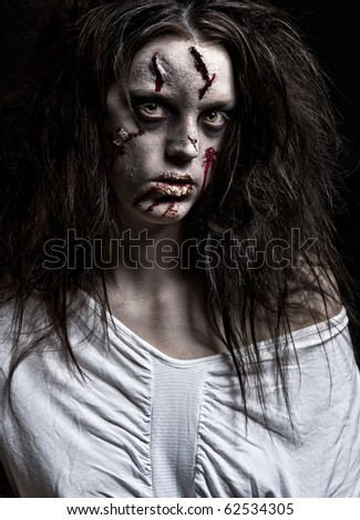 A Scary Looking Girl Possessed By A Demon Stock Photo ...