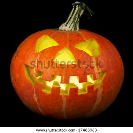 A scary old jack-o-lantern on black...