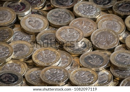 A Scattered Pile British One Pound Coins £1 Sterling #1082097119
