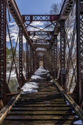 A scene of an abandoned Pratt through truss along the former Delaware and Hudson Railroad in Harpursville, New York.