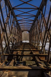 A scene of an abandoned quadrangular lattice through truss along the former Delaware and Hudson Railroad in Pennsylvania.