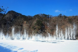 A scene of blowing up explosion the frozen river