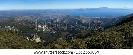 A scene of north Attica and the island of south Evoia, as seen from the top of mountain Penteli near Athens, Greece.