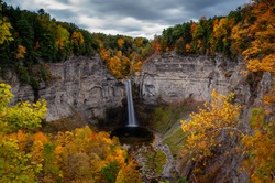 A scenic, autumn view of Taughannock Falls (waterfall) at Taughannock Falls State Park near Ithaca, New York.