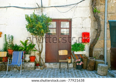 A scenic doorway to an ancient home in Portugal village.