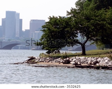 a scenic shot of the Potomac River with a Washington, DC city park and the Roslyn, Va. skyline in the background