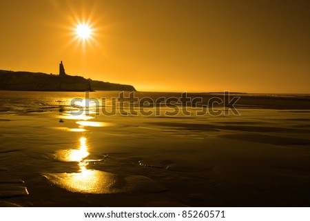 a scenic view of a castle on the irish coastline at ballybunion at sunset