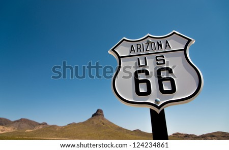 A scenic view of a historic Route 66 sign with a sky blue background #124234861