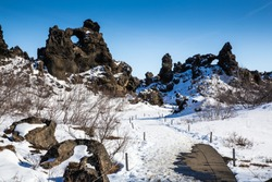 A scenic view of lava rock formation at Dimmuborgir, North Iceland