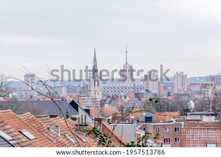 A scenic view of Leuven: the town hall and the serviced apartment blocks of St Maartensdal. Taken with 50mm lens, winter in January 2021, in Leuven, Belgium