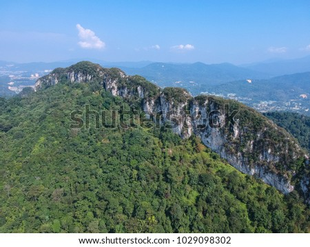 A Scenic view of Rocky Hill surrounded by forest outskirt of Kuala lumpur City. It is a legendary place for nature hiking #1029098302