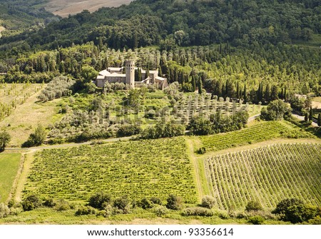 A scenic viewpoint of an old monastery estate surrounded by olive orchards and vineyards in the hilly countryside of Umbria near Orvieto in Italy.