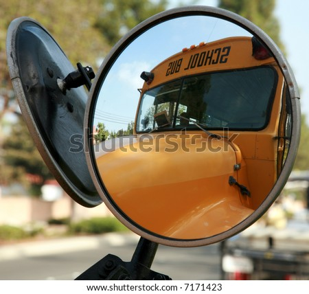 a school bus as seen from its convex mirror