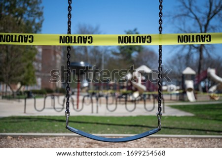 A school playground in Michigan is sealed off with cordon tape. The State closed all schools in an effort o thwart the spread of the novel coronavirus.  Foto stock ©