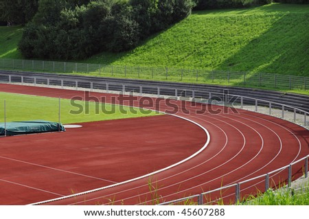 A school's running track and football field with high jump