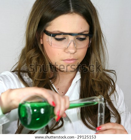 A science student pours a green solution