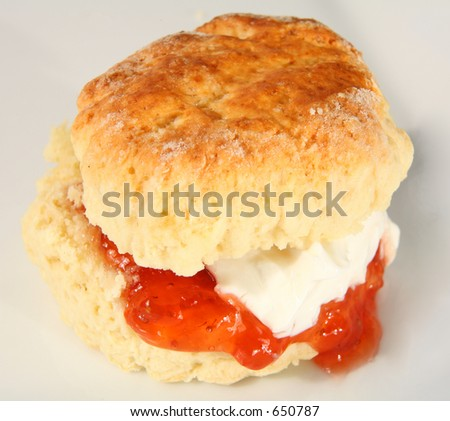 A scone filled with jam and cream