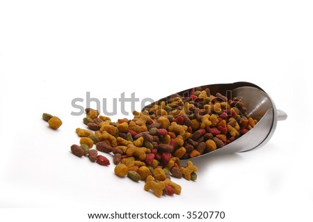A scoop of dog food, isolated on white