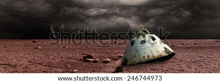 Stock Photo A scorched space capsule lies abandoned on a barren world. Storm clouds and lightning are the background of a failed mission. - Elements of this image furnished by NASA.