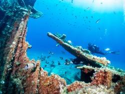 A scuba diver explores a sunken shipwreck in the Aegean Sea of Greece