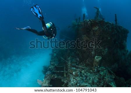 A scuba diver in deep blue of indian ocean. Picture take in Ari atoll - Maldives.