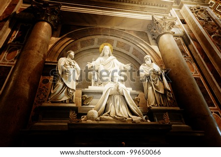 A sculpture in St. Peter's basilica Jesus, Saint Paul, Saint Peter and a pope